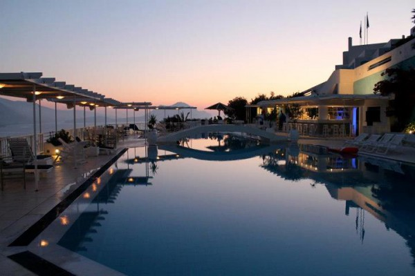Aegialis Hotel and Spa  sunset by the pool